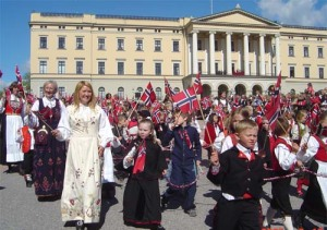 Norwegians parading in national costume before the palace in Oslo
